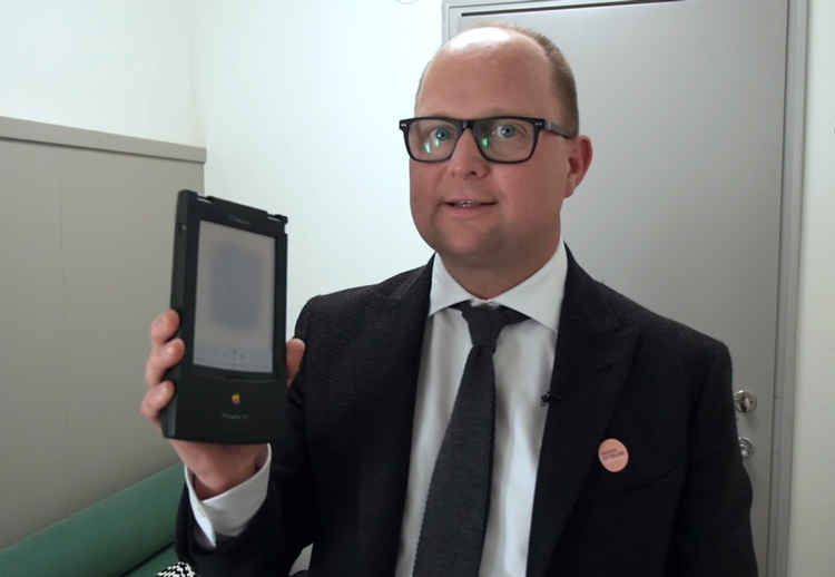 The creator and curator Samuel West with the Apple Newton in his hands