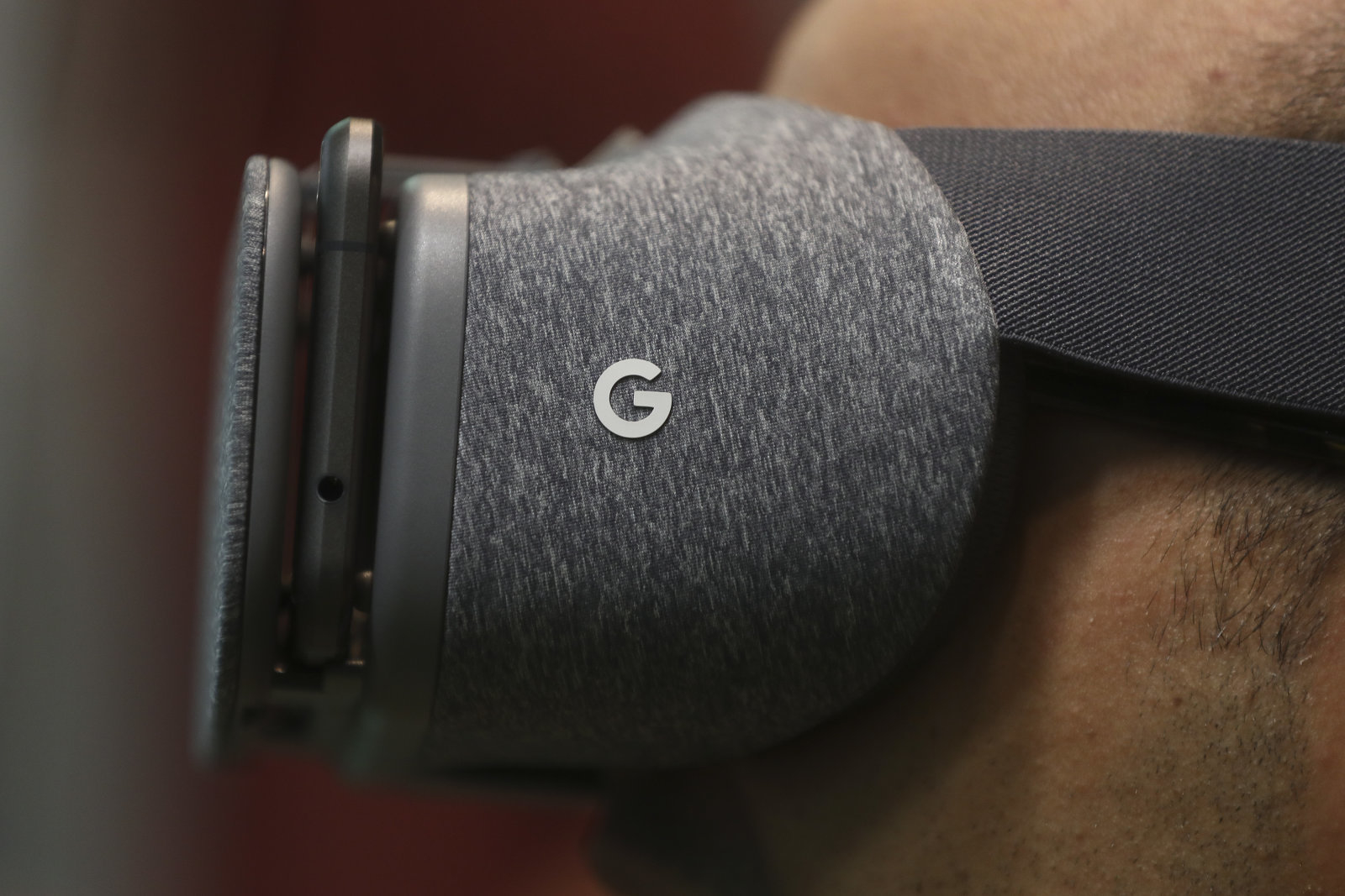 An attendee wears the Google Inc. Daydream View virtual reality (VR) headset during an event at Google's Kings Cross office in London, U.K., on Tuesday, Nov. 15, 2016. After being criticized for not paying its fair share of British tax, Alphabet Inc.s Google unit is trying to show its a good corporate citizen by offering five hours of free digital skills training to all U.K. residents. Photographer: Simon Dawson/Bloomberg via Getty Images